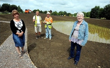 Pearl Stokes, right, chairman of the Churchdown Parish Council, and Ruth Warne, left, clerk, with Tom Blackwell and David Bryant, of constructors DE Spencer and Sons, at the new wildlife ponds designed by Water21 (photo credits The Gloucester Citizen)